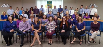 MAG employees wear purple to support Domestic Violence Awareness Month