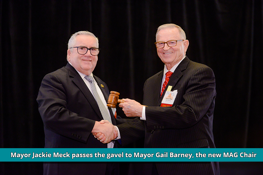 Mayor Meck passes the gavel to Mayor Barney