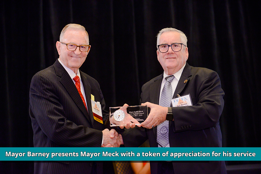 Mayor Meck receives a gift for his service as MAG Chair